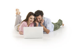 Couple with laptop. On the floor Royalty Free Stock Image
