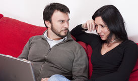 Couple with Laptop Stock Photography