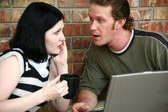 Couple with Laptop Stock Images