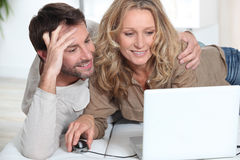 Couple on laptop. Royalty Free Stock Image