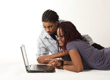 Couple with Laptop. An African American couple looking at a laptop stock image