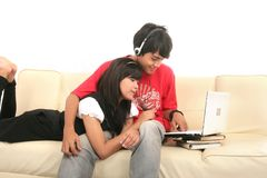 Couple with laptop. Couple relaxing with laptop on sofa Royalty Free Stock Photos