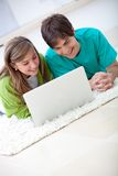 Couple on a laptop Royalty Free Stock Photos
