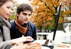 Couple laptop autumn park Royalty Free Stock Images