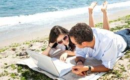 Couple Laptop Beach Stock Image