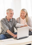 Couple With Laptop Calculating Bills At Home Royalty Free Stock Image