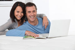 Couple with a laptop computer Stock Photography