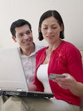 Couple With Laptop And Credit Card Royalty Free Stock Photography