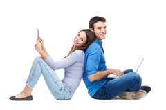 Couple with laptop and digital tablet Royalty Free Stock Photos