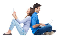Couple with laptop and digital tablet Stock Image