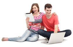 Couple with laptop and digital tablet Royalty Free Stock Images