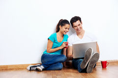 Couple laptop floor Stock Photos