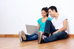 Couple laptop floor Stock Image