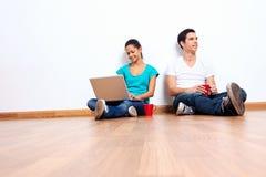 Couple laptop floor Stock Photography