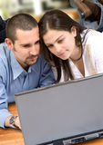 Couple on a laptop at home Stock Photography
