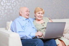 Couple with a laptop at home Royalty Free Stock Photo