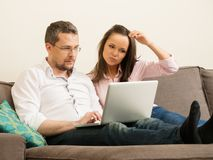Couple with laptop in home interior Stock Photography