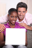 Couple with a laptop. Royalty Free Stock Photography
