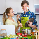 Couple with laptop at kitchen Royalty Free Stock Photo