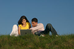 Couple with laptop in nature Royalty Free Stock Photo
