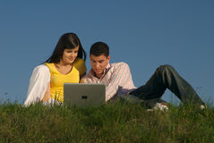 Couple with laptop in nature Stock Photos