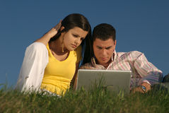 Couple with laptop in nature Stock Photography