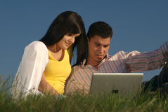 Couple with laptop in nature Royalty Free Stock Photos
