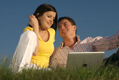 Couple with laptop in nature Stock Image