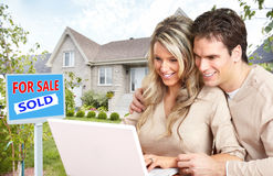 Couple with laptop near new house. Stock Photo