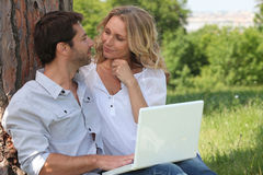 Couple with a laptop outside Stock Photography