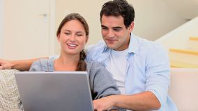 Couple with a laptop stock video footage