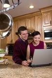 Couple with Laptop - Vertical Stock Images