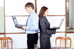 Couple with laptops Stock Image