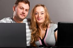 Couple with laptops Stock Photo