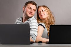 Couple with laptops Royalty Free Stock Photos