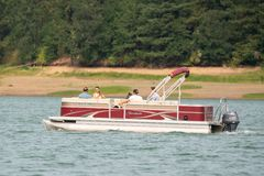 Couple on the large boat on the lake stock image