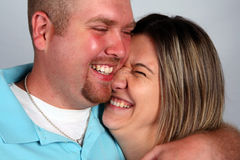 Couple Laughing. A man and woman share a funny, happy moment Stock Photography
