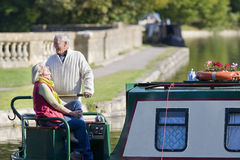 Couple laughing on boat in canal Royalty Free Stock Photo
