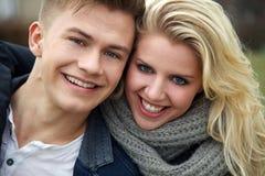 Couple laughing at camera Royalty Free Stock Photos