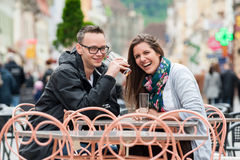 Couple laughing at coffee terrace Royalty Free Stock Photo