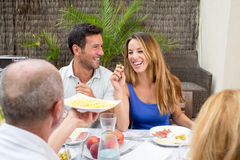 Couple laughing during family lunch Royalty Free Stock Photography