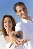 Couple Laughing Holding Hands on A Beach Royalty Free Stock Photo