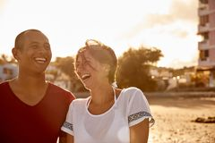 Couple laughing joyously on the beach Royalty Free Stock Photo