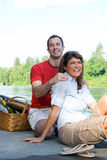 Couple Laughing by a Lake - Vertical Royalty Free Stock Photo