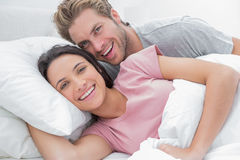 Couple laughing and looking at camera Royalty Free Stock Photos