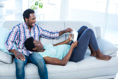 Couple laughing and looking at tablet Royalty Free Stock Photography