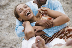 Couple laughing, man embracing woman, close-up stock photography