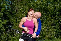 Couple Laughing Next to Bike - Horizontal Stock Images
