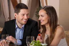 Couple laughing in a restaurant. Happy couple laughing in a restaurant, horizontal Royalty Free Stock Images