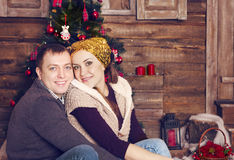 Couple laughing together near the Christmas tree Royalty Free Stock Images